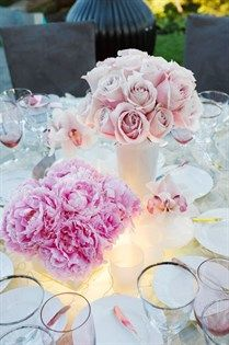 Full, pink peonies paired with roses, cymbidium orchids and tealights in frosted glass vases are completely stunning.