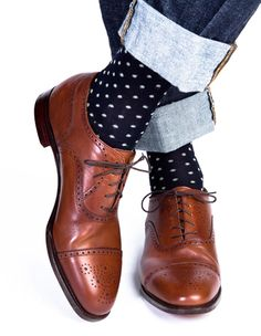 white polka dots on the blue socks, with brown shoe and bluejean..thats the way boy!