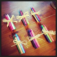 Children's wedding favours with colouring books, all wrapped in raffia