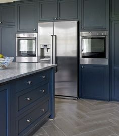 Read This Before You Paint Your Kitchen Cabinets The soft, almost matte finish on the navy-blue doors and drawers in this handsome kitchen fades into the background, leaving the gleaming stainless-steel appliances to shine through. Dark Blue Kitchen Cabinets, Dark Blue Kitchens, Painting Kitchen Cabinets, Kitchen Cabinet Design, Kitchen Interior, Cupboards, Narrow Kitchen, Modern Cabinets, Navy Cabinets