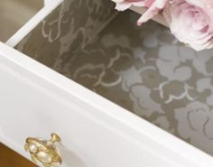 Creative ways to use a roll of wallpaper: Measure the drawer base and sides and use a plain paper templates a guide to cut out your wallpaper shapes. Take care to make sure that the pattern repeat matches. Stick on place with PVA glue. Find more inspiration at housebeautiful.co.uk