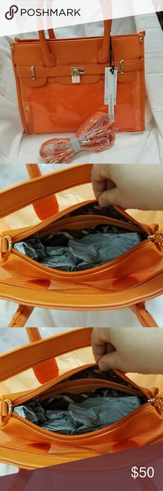 La Terre fashion purse What a great color for spring! Purse has top zipper compartment to front pockets that are clear. Comes with shoulder strap and small bag inside La Terre Bags