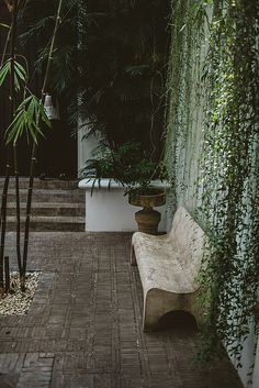Patio with a weathered parquet floor and hanging vines | The Siam + Central Thailand