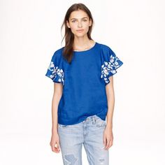 ISO J Crew embroidered lining blue flounce top 2 ISO j crew embroidered blue linen flounce top. If you are selling this top in a size 2, I need it! Thanks! J. Crew Tops