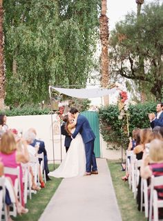 Photography : Christine Doneé Photography | Event Planning : Chic Productions | Wedding Dress : Johanna Johnson | Bridesmaids Dresses : Chi Chi London | Venue : La Quinta Resort & Club Read More on SMP: http://www.stylemepretty.com/2017/01/16/hot-pink-palm-springs-wedding/