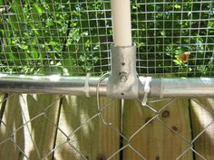 Close-up. Used brace rail clamps found in the chain link section & bolts that were a little longer. (Image 2 of Coyote Rollers, Chain Link Dog Kennel, Pvc Roofing, Cheap Chicken Coops, Dog Kennel Cover, Dog Pen, Cat Enclosure, What To Use, Chicken Runs