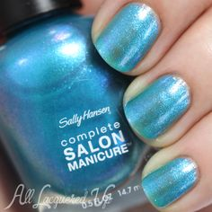 Sally Hansen Searsucker is a sheer pale turquoise foil metallic with a hot pink flash. It shows up on the nail but it's hard to capture on camera so I'm showing the bottle instead. Compared to Formula X Photoelectric, this is lighter, more sheer and doesn't have the same depth.