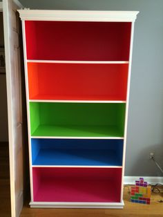 Tetris inspired bookcase: glidden red geranium, behr dragon fire, limeade, celebration blue, tutti frutti