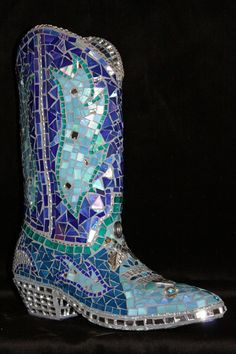 This is absolutely a of a kind blinged out cowgirl boot in shades of turquoise and blue. I started with a real size 8 leather boot ,filled with