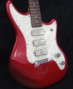 Schecter Hellcat 10-string in Candy Apple Red -- late 90s. Love the SD mini-hums and the big chunky Gretsch-style knobs.