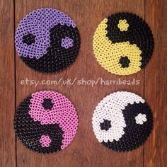 Set of 4 Yin and Yang Coasters (Ying Yang, Ying and Yang coasters) made from hama beads.  FOur different coloured Yin and Yang coasters - White and