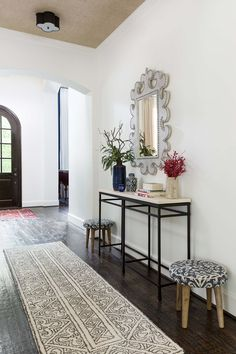 The hallway with textural wallcovering on the ceiling, new console, mirror, rug and surface mount light fixtures. Mirrored Furniture, Custom Furniture, Entry Hall, Front Entry, Entrance, Blue Glass Tile, All White Kitchen, Bookshelf Styling, Console Mirror