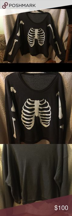 Wildfox Skeleton Sweater Small Wildfox Skeleton Bones Sweater   Wide and A little on the shorter side, some might call this fit cropped, but not dramatically. It is a dark gray with black banding on the wrists and waist. Bones are white with a purposeful distressful look to them. This Sweater is still so soft on the inside and ready to be worn instead of hiding out in my closet!!!  SIZE: Small, but oversized, so can fit S-L  CONDITION: Great! It has been well taken care of!   MATERIAL: 70%…