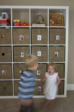 Playroom storage with picture labels so even pre-readers know where things go...brilliant!