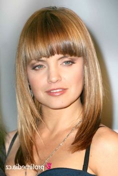 Love the length, maybe side swept bangs.