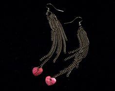 red shell heart and gunmetal toned chain tassel long earrings. $15.00, via Etsy.