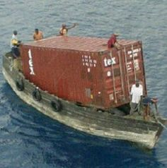 "The smallest container ship on earth... ""Salvaging"" a lost container from a container ship?"