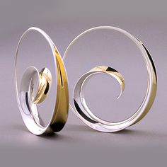 Contemporary Hoop Earrings made of Sterling Silver and 18K Yellow Gold Bimetal by the Anticlastic Raising technique. Hammered and buffed to a high polish.