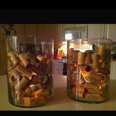 Wine cork filled hurricane lamp with tea light!!!  DIY I found on Pinterest. Looks great!!!  Great decor for wine tasting or fondue party?!!!