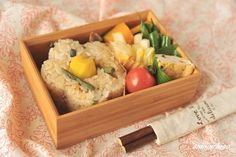 """""""Japanese bento blogger Akinoichigo is best known as a charaben artist, but she also makes elegant bentos for adults (herself), like this one featuring mixed mountain-vegetable rice that's been molded into an flower (ume plum blossom) shape."""""""