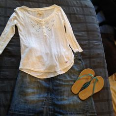 Cute Hollister Shirt  White marled look with half sleeves.  Blue and white rhinestone detailing around the neckline. Size small. In very good condition!!  Hollister Tops Blouses