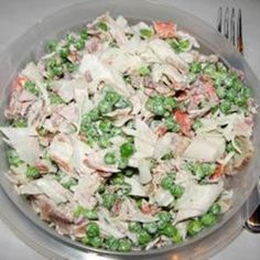 Crab and Pea Salad   8 slices bacon or turkey bacon  1 (10 ounce) package frozen green peas, thawed  1 pound imitation crab meat, flaked  1/2 cup fat free mayonnaise  1/4 teaspoon onion powder