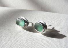 Turquoise sea glass studs, bezel set in silver.