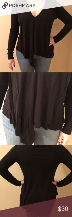 Asymmetrical black long sleeved Top Perfect condition. Smoke free home. Short in the front long in the back. BCBGMaxAzria Tops