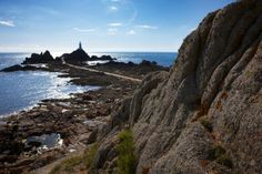 Not all beaches need sand. The coast in Corbiere is mainly rocks. But when the tides out it's like a lunar landscape. Jersey Channel Islands, Sandy Beaches, Places To Travel, Rocks, Coast, Mountains, Landscape, Park, Water