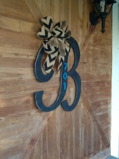 Black French B, distressed wood, with chevron burlap bow. 701 being a house number!!