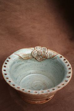 ceramic pottery jewelry bowl by californiasoulshine on etsy. You can hang earrings around the pierced rim