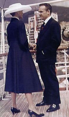 Grace Kelly in a navy Ben Zuckerman coat, arriving in Monaco with Prince Ranier