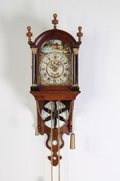 weight driven brass posted verge movement, half hour countwheel striking and alarm on a bell, maddered oak case with pierced 'sunwheel' tail. Antique Wall Clocks, Old Clocks, Plywood Furniture, Kit Kat Clock, Modern Clock, Clock Art, Clock Movements, Grandfather Clock, Vintage Keys