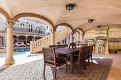 Outdoor kitchen and dining room is a sight to behold.