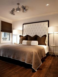 Attractive Double Ceiling Fans Over Brown Bedding Set Plus Tall White Tufted Headboard