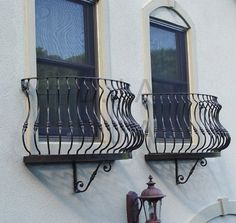 Elegant window balcony used as a flower box.