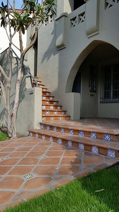 Saltillo Tile Walkway and Stairs are further embellished with hand-painted ceramic tiles. | Avente Tile
