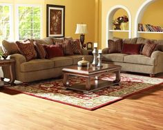 Like the yellow walls, neutral sofa, and then the pop of red pillows and red rug.  Walker Living Room Collection | Wayfair