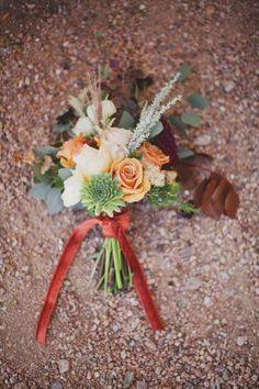 velvet ribbon-tied bouquet, photo by Joni Bilderback, flowers by Bash Please http://ruffledblog.com/bohemian-santa-fe-wedding #bouquet #flowers