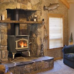 Wood stoves provide quality heat to any home. Also wood stoves are low maintenance, improve heating efficiency & have beautiful modern wood stove designs. Wood Stove Decor, Wood Stove Wall, Wood Stove Surround, Wood Stove Hearth, Stove Fireplace, Wood Fireplace, Wood Burner, Fireplace Design, Fireplace Ideas