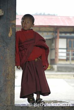 A young monk pauses for reflection in Bhutan.