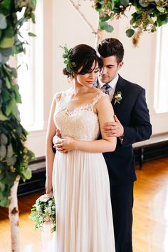 Romantic Classic Bride and Groom Under the Ceremony Arch | Alisha Maria Photography | http://heyweddinglady.com/modern-indoor-garden-wedding-elegant-ballroom/