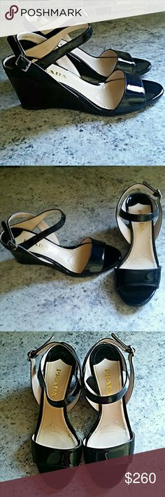 Prada Wedge Heels The perfect summer shoe! Gorgeous Prada black patent leather wedge heels. Beautiful condition. Some wear on inside. One light mark on upper heel of right shoe. (Pics 4 and 5) Leather. Rubber sole. Size 36. Made in Italy. Prada Shoes Wedges