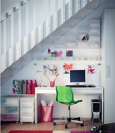 Instead of seeing the space under the stairs as a utility room, see it as a productive working space