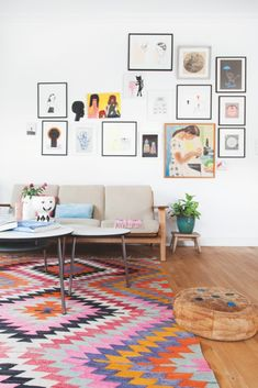 #printed #rug #leather #pouffe #living #room #space #wall #art #frame #home #interior #style