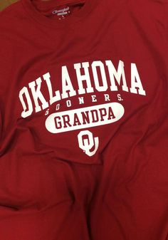 Show everyone you root for the Sooners with this Oklahoma Sooners Crimson Grandpa Short Sleeve T Shirt! Rally House has a great selection of new and exclusive Oklahoma Sooners t-shirts, hats, gifts and apparel, in-store and online. University Of Oklahoma, Oklahoma Sooners, Grove Oklahoma, Boomer Sooner, Mom Shirts, Short Sleeve Tee, Grandparents, Poppy, Champion