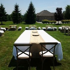 Reception set-up prior to the actual event.  Guest tables were made of rustic wood and bales of hay for seating.  Head table had a his & her matching chairs and benches from the ceremony.  #JandR25yrs #hbevents #hazelboivin #weddingplanner #torontobride #torontoplanner #torontowedding #durhamwedding #durhamweddingplanner #vowrenewal #rusticdecor #rusticwedding #eventdecor #eventstyling