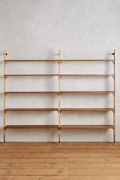 Kalmar Ten-Tier Wall Mounted Shelf by District Eight in Brown Size: All, Storage at Anthropologie Unique Living Room Furniture, Hanging Furniture, Furniture Design, Office Furniture, Office Chairs, 1970s Furniture, Hanging Chairs, Cottage Furniture, Studio Furniture
