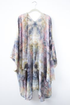 """Hand Dyed Silk Kimono/Cape. Desert inspired colors of Sage Green, Peach, Pink, Black and Grey. Billowy, romantic and so easy to wear. Made to order with a one week ship time. One size fits most (54""""x76"""") Hand Wash with gentle detergent and air dry or Dry Clean. Allow 2 weeks for shipping*Please note that you will not be receiving this cape, but one extremely similar. Because each cape is dyed individually each one will be unique and vary slightly in color and pattern."""