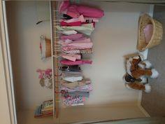 Kids closet after shot www.doubletakeorganizing.ca